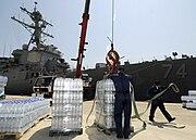 Loading bottled water on the USS McFaul (DDG 74)
