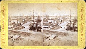 Wharf - Long Wharf in Boston, United States, c. 19th century, jutting into Boston Harbor