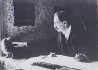 Louis Wain at his drawing table 1890.png