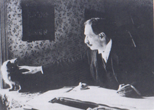 Louis Wain at his drawing table 1890.png