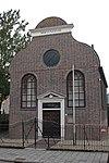 Lutherse Kerk. Zaalkerkje met aan de voorzijde een gezwenkte topgevel