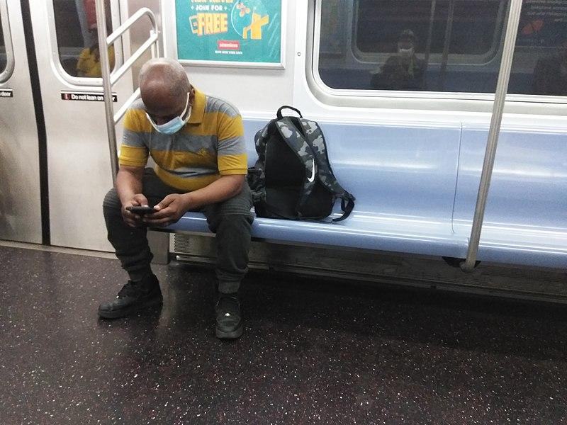 File:MTA New York City Subway riding wearing a facial mask.jpg