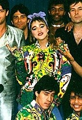 Madonna smiling, surrounded by dancers