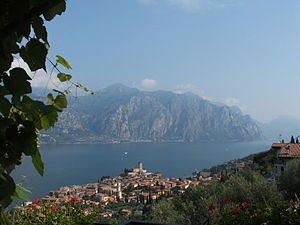 Malcesine - View of Malcesine on lake Garda, with church of St. Stephen and Castello Scaligero, and Limone sul Garda on opposite shore.
