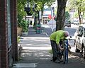Man Chaining a Bicycle.jpg