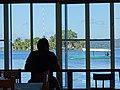 Man in Bar with Lake Peten Itza Backdrop - Flores - Peten - Guatemala (15860923951).jpg
