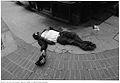 Man lying on street.jpg