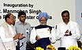 """Manmohan Singh releasing the Commemorative volume of a book """" Textiles & Beyond"""" on the occasion of the Golden Jubilee Celebrations of Confederation of Indian Textile Industry (CITI), in New Delhi on March 18, 2008.jpg"""