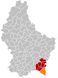 Map of Luxembourg with Schengen highlighted in orange, the district in dark grey, and the canton in dark red