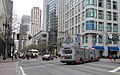 Market St at Fourth St in San Francisco with streetcar and ETI trolleybus (2011).jpg