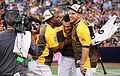 Marlins teammates Marcell Ozuna and Jose Fernandez congratulate Giancarlo Stanton after he won the T-Mobile -HRDerby. (28476386321).jpg