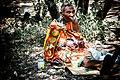 Masai woman making a beaded necklace.jpg