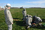 Master Sgt. Robert Burns views airmen evaluating Delaware CAP cadet.JPG
