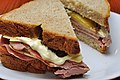 Meat and cheese sandwich with pickle and mayonnaise.jpg