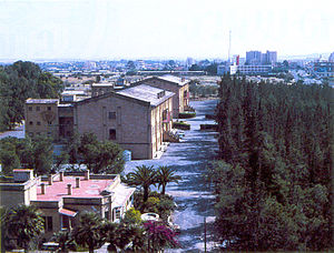 """Melkonian Educational Institute - Panoramic view of the Melkonian Educational Institute (1986) and """"The Forest of Remembrance"""" on the right."""