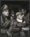Members of the 332nd Fighter Group attending a briefing in Ramitelli, Italy, March, 1945 - 13245u.tiff
