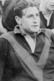 Miller sporting a cut nose during a football match