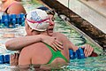Missy Franklin embraces Allison Schmidt after winning 200 free (9002768212).jpg