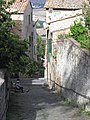 Montalcino Street with Women in the Afternoon - panoramio.jpg