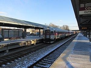 Montello (MBTA station) - An inbound train arrives at Montello station in 2013