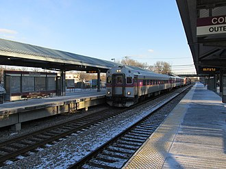 Montello station - An inbound train arrives at Montello station in 2013