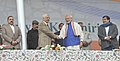 Narendra Modi at the public meeting at Sher-e-Kashmir cricket stadium, in Srinagar. The Chief Minister of Jammu and Kashmir, Shri Mufti Mohammad Sayeed, the Union Minister for Road Transport & Highways and Shipping.jpg