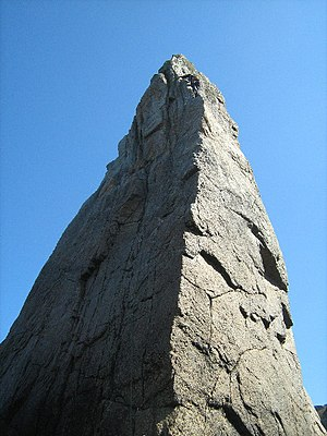 English: Needle Rock There is a climber just b...