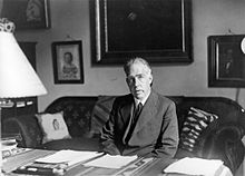 Bohr sitting at his desk