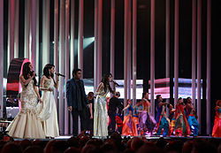 Male singer with female singers and dancers