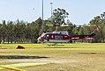 O'Driscoll Aviation (VH-HUE) Bell UH-1H Iroquois landing on a oval at Hammondville Park.jpg