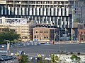 Old Railrood Police building being overwhelmed by Construction of the Pan Am Athlete's Village, 2013 07 20 -a.JPG - panoramio.jpg