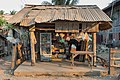 Old little shop with corrugated iron roof, selling drinks and petrol, in Don Khon, Laos.jpg