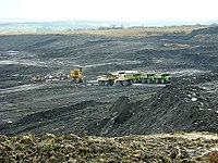 A large pit of coal