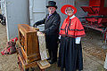 Organ grinder with red cape lady - A Victorian Christmas, Audley End House, 2014-11-29.jpg