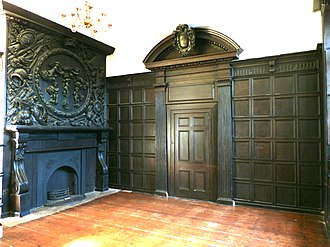 Potheridge - Overmantel at Potheridge with antique trophy of arms and crowning putti