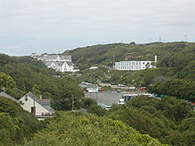 Porthcurno Valley looking north showing the car park and a few of the former Engineering College buildings
