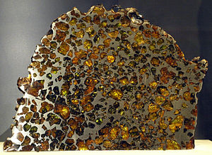 Esquel (meteorite) - Polished slices of the stony-iron Esquel pallasite: at the Canadian Museum of Nature (left), at the American Museum of Natural History (middle) and encased yellow-green olivine crystals in the iron-nickel matrix are clearly visible (right).