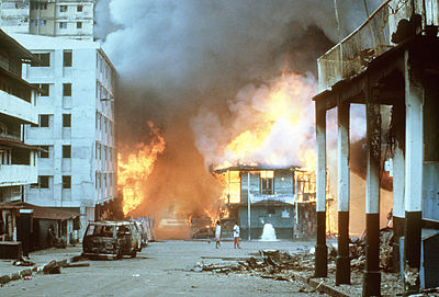 Flames engulf a building following the United States invasion of Panama Panama clashes 1989.JPEG