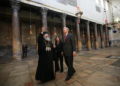 President George W. Bush listens as Theophilos III, Patriarch of Jerusalem, speaks during a visit to the Church of Nativity Thursday, January 10, 2008, in Bethlehem. Patriarch Theophilos III of Jerusalem and President Bush.jpg