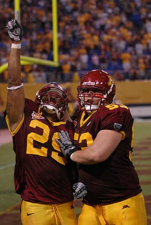 Minnesota Golden Gophers football - Amir Pinnix celebrates a touchdown with D.J. Burris on September 1, 2007.