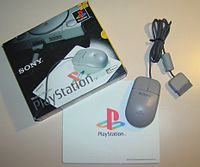 The PlayStation Mouse, mouse mat and packaging.