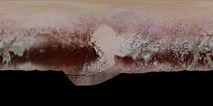 "Geography of Pluto - The portions of Pluto's surface mapped by New Horizons (in enhanced color). Center is 180 degrees longitude (diametrically opposite the moon Charon). The bright area in the center is Tombaugh Regio. The dark area to the west is Cthulhu Regio. The series of dark areas to the east are the ""Brass Knuckles""."