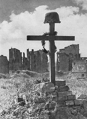 Grave of a Polish Home Army resistance fighter killed during the Warsaw Uprising. The battle lasted 63 days and resulted in the deaths of at least 150,000 civilians in 1944. Polish Soldier's Grave Warsaw 1945.jpg