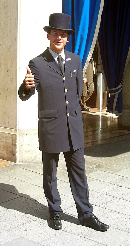 A hotel porter is an example of a service-related occupation. Portier mit Zylinder.JPG