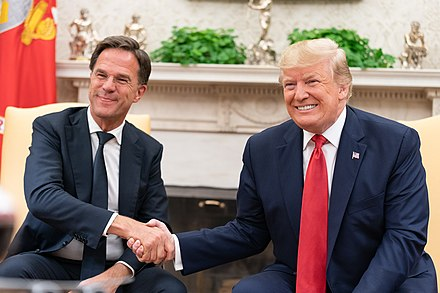 Rutte with U.S. President Donald Trump in the Oval Office of the White House on 18 July 2019 President Trump Meets with the Prime Minister of the Netherlands (48317652116).jpg