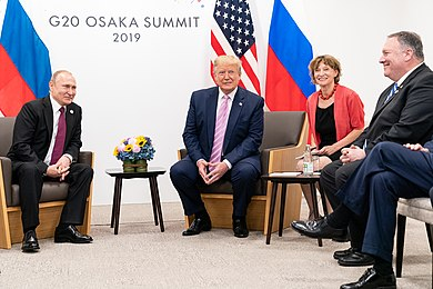 U.S. President Donald Trump (right), U.S. Secretary of State Mike Pompeo and Russian President Vladimir Putin (left) meet in Osaka, Japan in June 2019. President Trump at the G20 (48144140002).jpg
