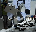 Protesters Throwing Shoes at Bush posters in Montreal.jpg