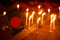 Protesters at Shahbag flag with candle.JPG