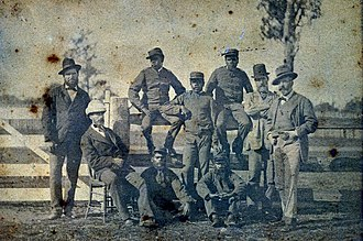 Aboriginal tracker - A contingent of Queensland Police trackers were sent to Victoria to help in the hunt for the Kelly Gang in 1879. The trackers along with Queensland and Victorian police officers pose in Benalla Police Paddock. Back Row L-R: Senior Constable Tom King (Standing); Troopers Jimmy, Hero and Barney and Victorian Police Superintendent J Sadlier. Front Row L-R: Queensland Sub-Inspector Stanhope O'Connor, Troopers Johnny and Jack and Victoria Police Commissioner, Captain Frederick Charles Standish (hands in pockets)