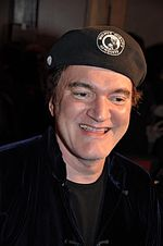Photo of Quentin Tarantino arriving at the Django Unchained premiere in France in 2013.